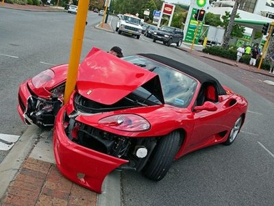 red car wrecked into a street pole