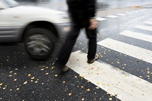 man in crosswalk about to be hit by car