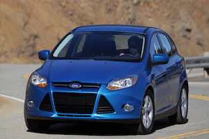 blue Ford vehicle driving on curvy road