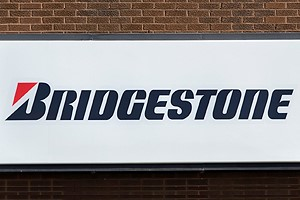 Sign outside building that says Bridgestone