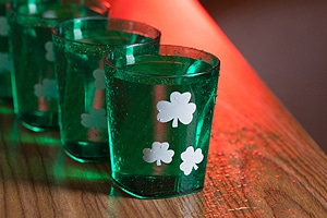 shot glasses in a line on a table