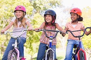 Happy children riding bicycles