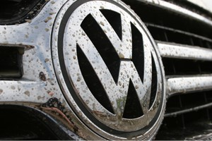 close up of Volkswagen emblem on front of car