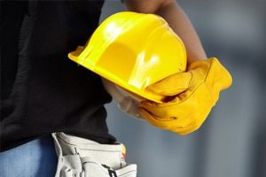 Worker holding a hard hat