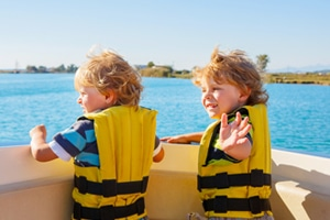 Young Kids on Boat wearing life jackets
