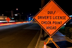 road sign that says DUI Checkpoint ahead
