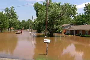 Flooded Tulsa street in residential area