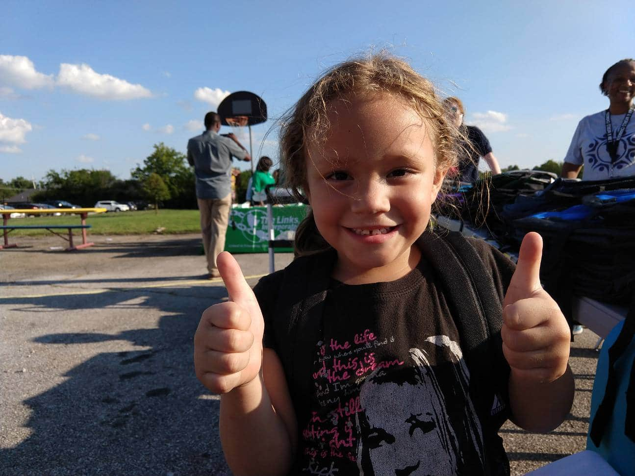 Child with Thumbs Up