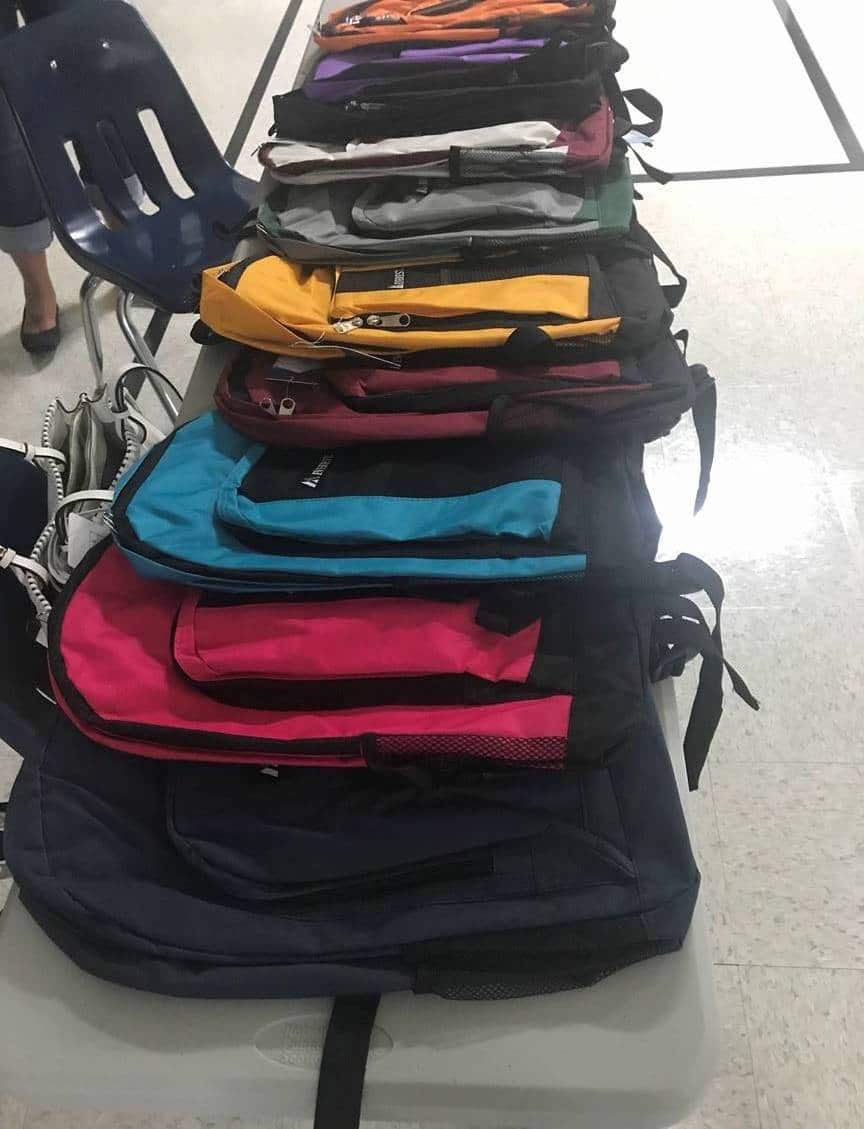 Different colors of backpacks lying in a pile
