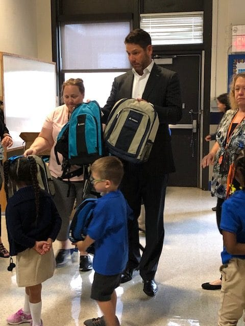 2019 Backpack Program Chad McLain passes out backpacks to children