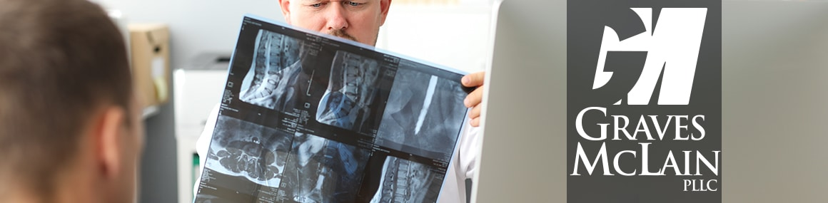 Doctor reviewing xrays with patient