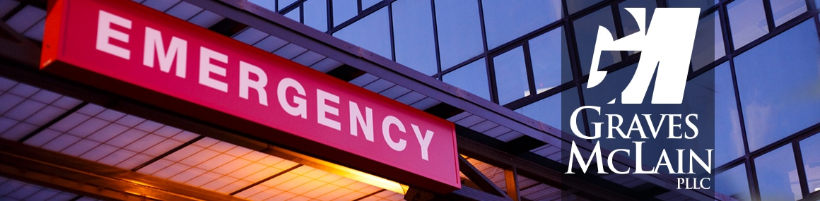 Picture of a sign that says Emergency outside a hospital