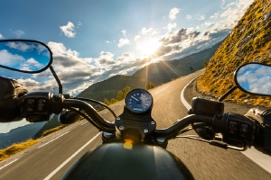 Motorcyclist riding on open road