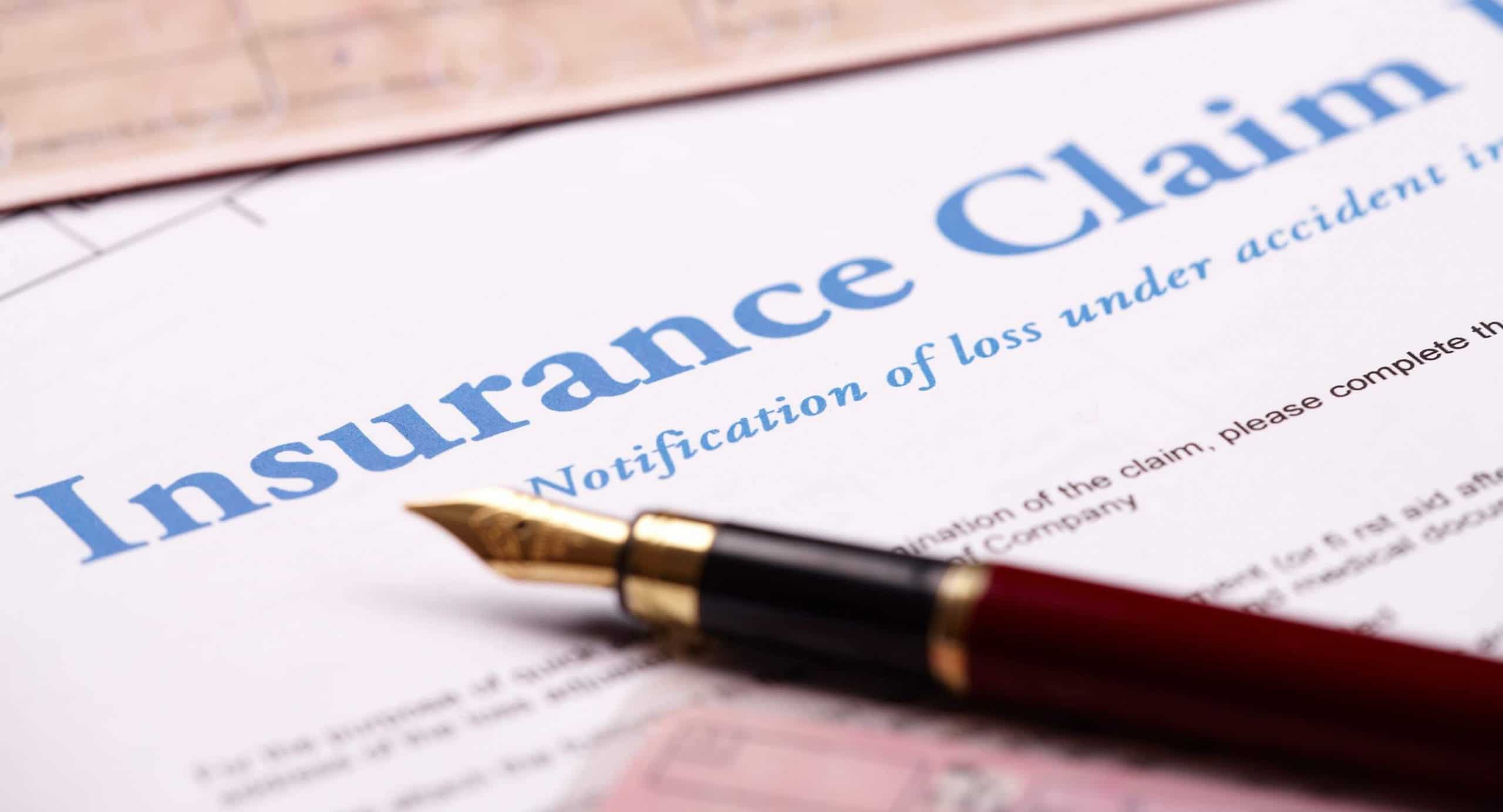 Blank insurance claim form and papers