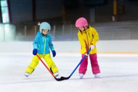children playing ice hockey