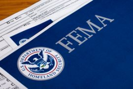 FEMA paperwork laying spread out on a table
