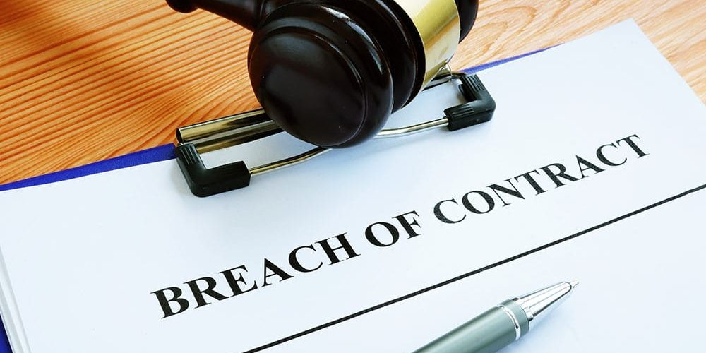 Breach of contract papers with pen and gavel