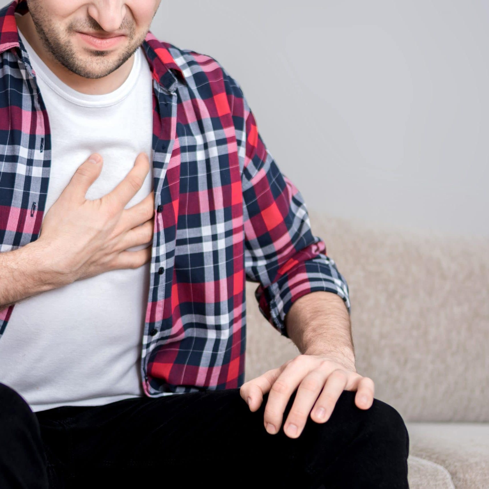 Man with chest pain suffering from heart attack